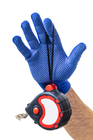 construction tool, tape measure in male hand on white isolated background