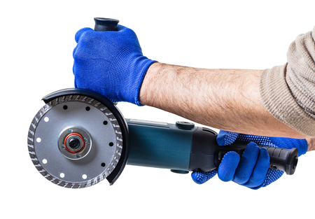 construction tool, power saw in male hand on white isolated background