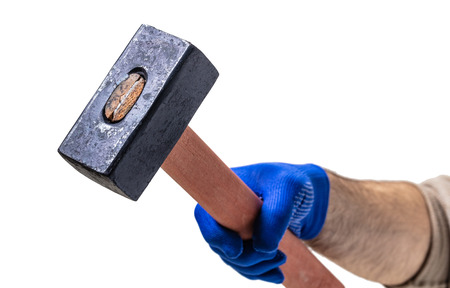 construction tool, new hammer in male hand on white isolated background