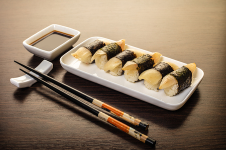 sushi set in a plate on wooden background