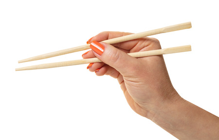 female hand with chopsticks on a white isolated background