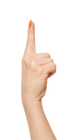 weibliche Hand mit erhobenem Zeigefinger, weißer, isolierter Hintergrund Standard-Bild