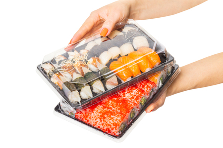 Sushi set hold hands, isolated white background Stock Photo
