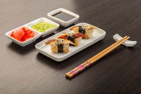Japanese food, sushi with eel on a wooden background