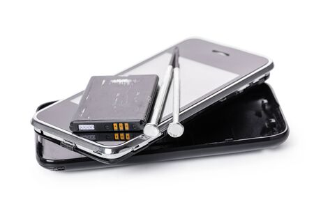 disassembled mobile phone and tools on white isolated background