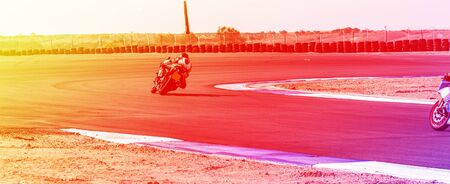 competition, motorcycle racer rides on a sports track