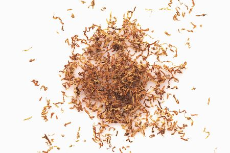pile of dry tobacco close-up on a white background