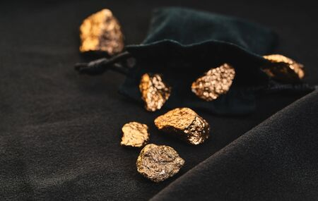 gold nuggets close-up on a black background