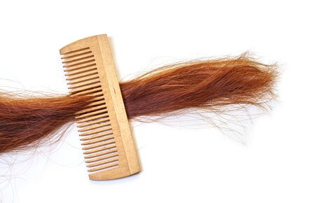 hairbrush with a lock of hair on a white background