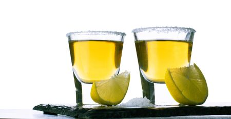 alcoholic drink with lemon and salt on a white background 版權商用圖片
