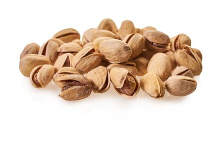 Pistachio nuts close-up on a white isolated background