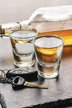 alcoholic drink and car keys on a dark background