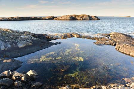 beautiful norwegian landscape lake with rocks in summer