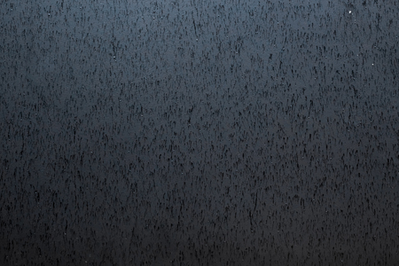 side effect: Old black wall. Black background. Black texture. Blackboard. Grunge wallpaper. a metal wall texture with traces of rain