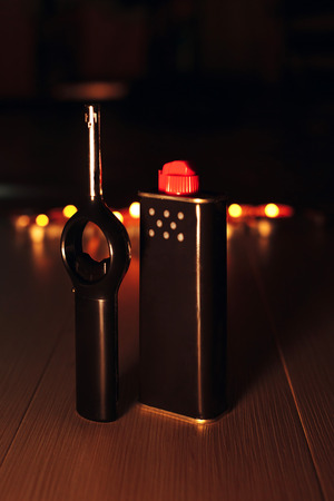 The barrel of fuel and petrol lighter on fire backround