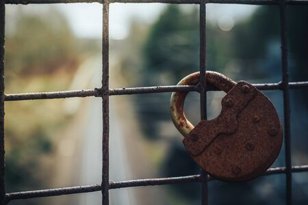 metal net: Old key lock on fence. The picture shows the ban on travel or movement by rail