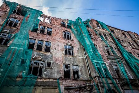 dismantle: closeup of building demolition after earthquake