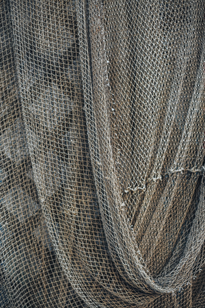 fishingnet: Dark green fishing nets weigh on the fence. Abstract background Stock Photo