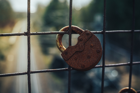 chainlink fence: Old key lock on fence. The picture shows the ban on travel or movement by rail