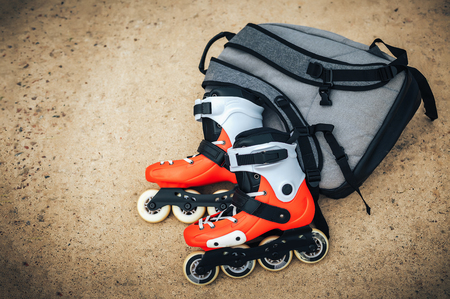 blading: Roller skates orange color on asphalt Stock Photo