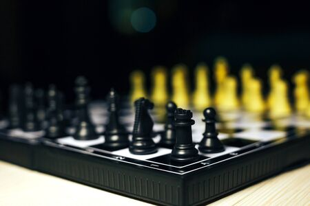 battle plan: Chess photographed on a chessboard