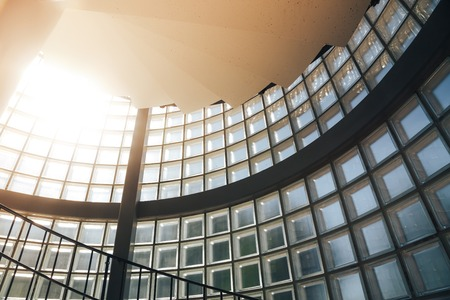 Sun shining modern hotel building stairway glass