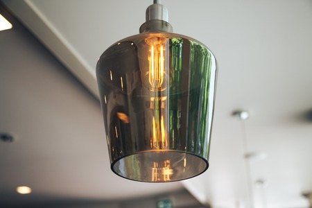 Incandescent lamps in a modern cafe. Edison lamp. Stock Photo