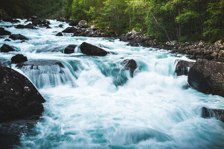 Wallpaper or backgrounds waterfall long exposure shot in the valley of the waterfalls in Kinsarvik Norway Stock Photo