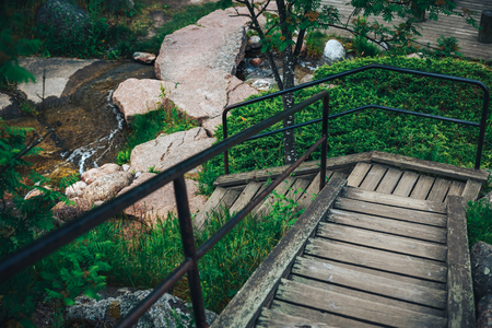 dominican: Empty wooden stairs goes down to the waterfall