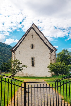 rooftiles: Old white church in Norway at sunny summer day