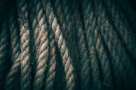corded: Dark background texture of coiled marine or nautical rope.Texture of synthethic mooring line. Close up Stock Photo