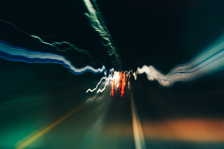 Truck light trails in tunnel. Art image . Long exposure photo taken in a tunnel Stock Photo