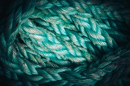 corded: Background texture of coiled marine or nautical rope.Texture of synthethic mooring line. Close up
