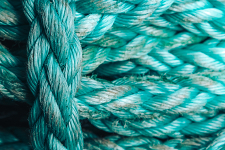 Background texture of coiled marine or nautical rope.Texture of synthethic mooring line. Close up