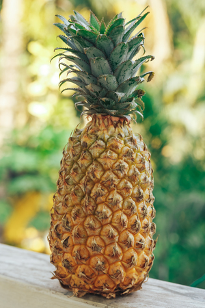 Pineapple on a wooden table. At the balcony. Stock Photo