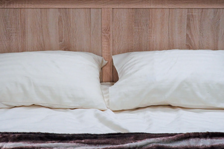 White pillows on a bed Comfortable soft pillows on the bed 스톡 콘텐츠
