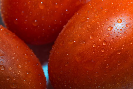 red tomatoes background. Group of tomatoes. Wallpaper tomato macro Stock Photo