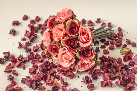 A bouquet of red and pink roses on the floor.