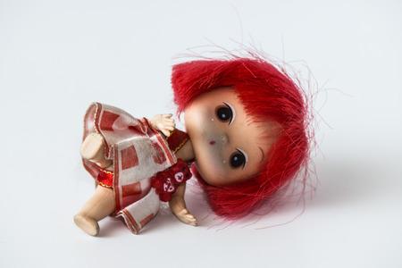 girl doll: Dirty Girl doll lying on the floor.