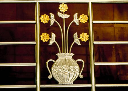 balustrades: Guard rail, stainless steel design, a vase of flowers.