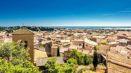 View of Gruissan in southern France. In the background the salt fields of the mediterranean sea. Stok Fotoğraf - 73599304