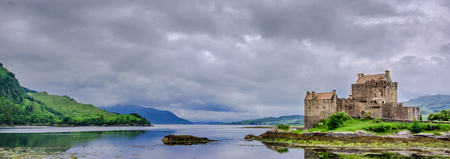 Lake and mountains: Eilean Donan Castle in Scotland.