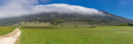 french way: French countryside. Landscape on the plateau of Vercors with cloud formation in the mountains. Stock Photo
