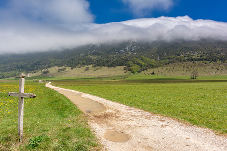 French countryside. Landscape on the plateau of Vercors with cloud formation in the mountains. Stock Photo