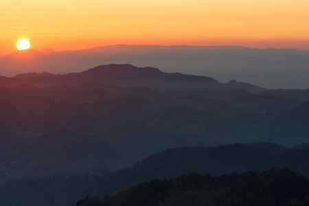 Autumn landscape - Black Forest. Panoramic view over the autumnal Black Forest, the Rhine valley and the Vosges (France) in the distance at sunset.