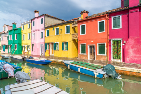 Colorful houses on Burano. A typical street and canal on the island of Burano near Venice. Stock Photo