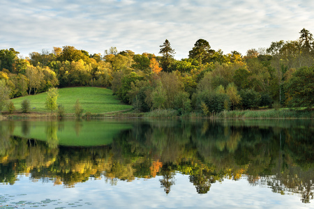 Autumn landscape in the southeast of England with trees and a lake in the foreground