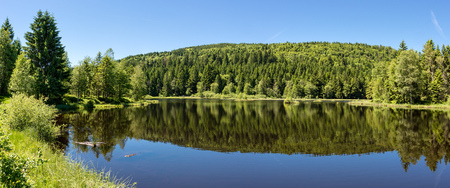 French countryside - Vosges. Panoramic view of a small natural lake in a valley of the Vosges. Stock Photo