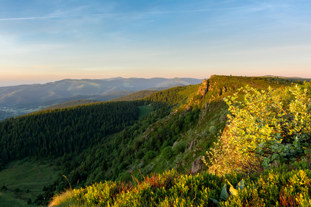 French countryside - Vosges. Sunrise in the Vosges with a view of the Rhine valley, the Black Forest and the Alps in the background. Stock Photo