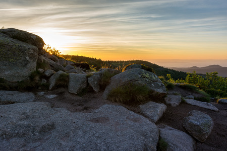 French countryside - Vosges. Sunrise in the Vosges with a hiking trail and rocks in the foreground.